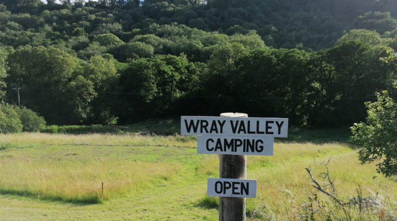 Wray Valley Campsite sign - open for business, view of camping field